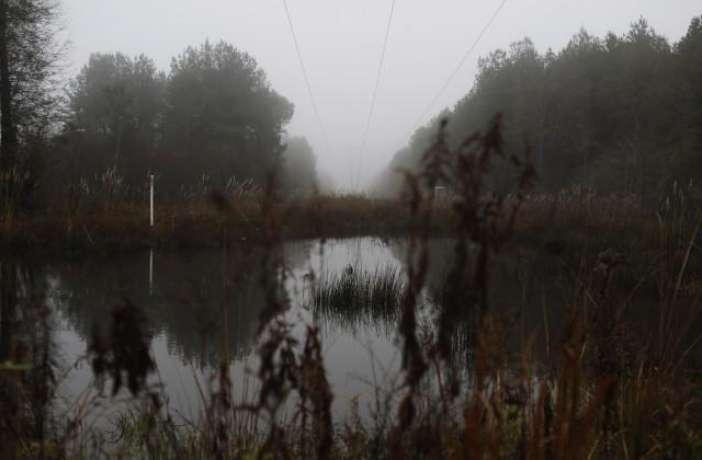 Дешевые похороны: родственники утопили мертвую женщину возере